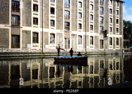 Fishermen fishing from a small boat in the La Villette Basin on the Ourcq Canal, Paris , France, Europe. - Stock Photo