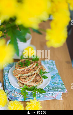 pancakes from vegetables on the table. Yellow flowers. Healthy food. Vegetarian - Stock Photo