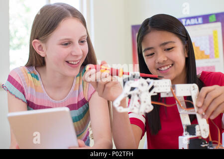 Two Female Pupils In Science Lesson Studying Robotics - Stock Photo