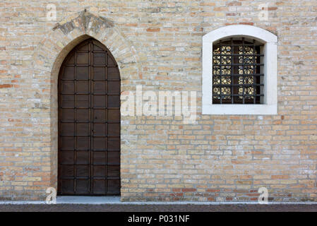 Wooden door and window on the facade of an historic building