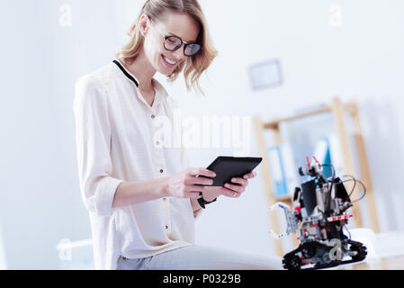 Happy nice woman using a tablet - Stock Photo