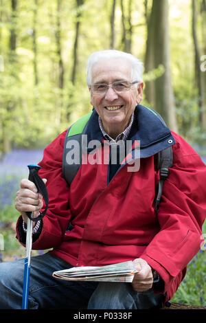 Portrait Of Senior Man On Walk Through Bluebell Wood - Stock Photo