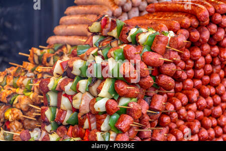 barbecue scenery with lots of various roasted sausages and meat skewers - Stock Photo