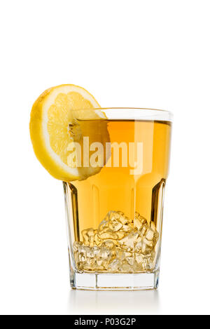 glass full of ice tea with lemon slices on white background - Stock Photo