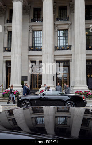 A polished black Bentley car parked outside the tall columns of the Four Seasons hotel at 10 Trinity Square in the City of London - the capital's financial district, on 4th June 2018, in London, England. - Stock Photo