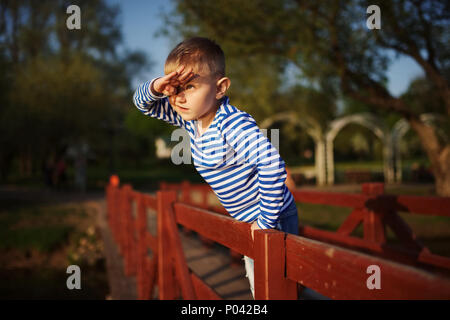 little boy looks into the distance - Stock Photo