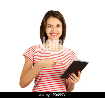 Portrait of a cheerful hipster woman pointing finger on tablet computer. emotional girl isolated on white background. - Stock Photo