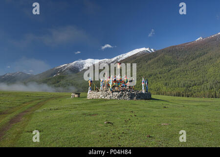 Kazakh stupa and prayer flags, Kanas Lake National Park, Xinjiang, China - Stock Photo