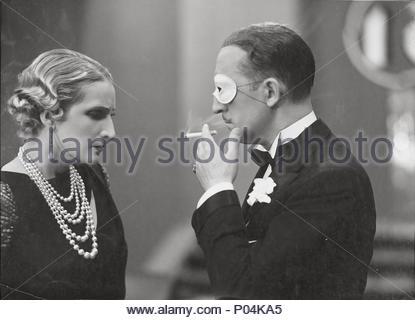 Original Film Title: DOCE HOMBRES Y UNA MUJER.  English Title: TWELVE MEN AND A WOMAN.  Film Director: FERNANDO DELGADO.  Year: 1934.  Stars: MARIANO ASQUERINO; IRENE LOPEZ HEREDIA. Credit: STAR FILMS S.A. / Album - Stock Photo