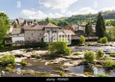 The Corn Mill a waterside pub and restaurant next to the Dee bridge in Llangollen North Wales on the River Dee - Stock Photo