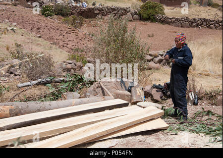 A local builder doing his work on Taquile island, Lake Titicaca. Peru - Stock Photo