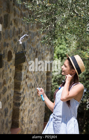 Young traveler making selfie. Girl in straw hat - Stock Photo