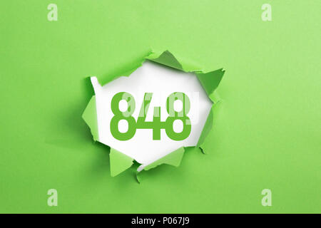 Green Number 848 on green paper background - Stock Photo