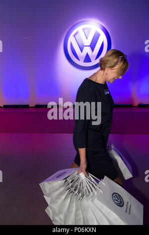 Wreschen, Poland, employee before the VW logo to the opening of the factory of VW commercial vehicles - Stock Photo