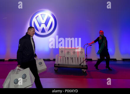 Wreschen, Poland, employees before the VW logo to the opening of the factory of VW commercial vehicles - Stock Photo
