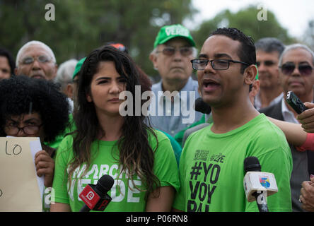 Natalia Mármol and Jonathan Liriano, members of the collective Marcha Verde, emerged after revealing the bribes for 92 million dollars that Odebrecht claimed to have distributed in the country between 2001 and 2014, speaks with the media after assemble a camp in front of the headquarters of the Attorney General's Office, in Santo Domingo, Dominican Republic, on 8 June 2018, place where they criticized the decision of the Public Ministry to exclude eight of the fourteen initially charged for this case. EFE/Orlando Barría - Stock Photo