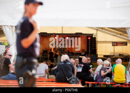 08 June 2018, Germany, Themar: Festivalgoers sitting in a tent at the 'Tage der nationalen Bewegung' festival. The 2-day festival attracts rightists from across Europe. Several counter-protests and events are planned. Photo: -/dpa - Stock Photo