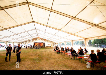 08 June 2018, Germany, Themar: People in a tent at the festival 'Tage der nationalen Bewegung'. The 2-day festival attracts rightists from across Europe. Several counter-protests and events are planned. Photo: -/dpa - Stock Photo