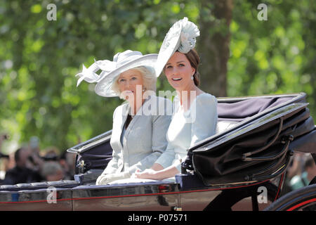 London, UK, 9 June 2018. HRH Catherine, Duchess of Cambridge and Camilla, Duchess of Cornwall ride a horse drawn carriage in the procession along The Mall, Trooping the Colour Credit: amanda rose/Alamy Live News - Stock Photo