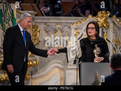 08 June 2018, Germany, Dresden: Award winner Nana Mouskouri, a singer from Greece, and speaker Klaus Wowereit, former mayor of Berlin, stand on stage at the award ceremony of the European Culture Prize 'Taurus' in the 'Frauenkirche'. The European Cultural Forum has its seat in Dresden and honours multiple people and institutions with the 'Taurus'-Prize, a bull made of bronze. Photo: Monika Skolimowska/dpa-Zentralbild/dpa - Stock Photo