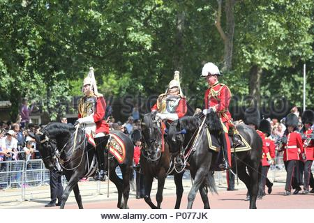 London, UK. 9th June, 2018. Field Marshal Charles Guthrie (middle) riding on horseback behind the Queen's carriage along The Mall after the 2018 Trooping the Colour / Queen's Birthday Parade. Moments later, he collapsed and fell off his horse. Credit: Katie Chan/Alamy Live News - Stock Photo