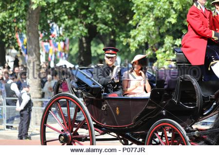 London, UK. 9th June, 2018. Prince Harry, Duke of Sussex & Meghan, Duchess of Sussex in horse-drawn carriage along The Mall. The 2018 Trooping the Colour / Queen's Birthday Parade. Credit: Katie Chan/Alamy Live News - Stock Photo