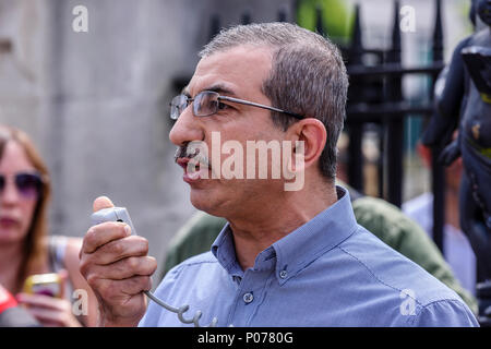 Belfast, Northern Ireland. 09/06/2018 - Dr Raied Al-Wazzan, from the Northern Ireland Islamic Centre speaks at the Northern Ireland Antifa protest against a rally in support of British First's Tommy Robinson, jailed in May 2018 for contempt of court. - Stock Photo