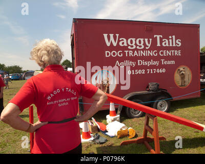 At a Suffolk village fete is parked the lorry of a dog display team - Stock Photo