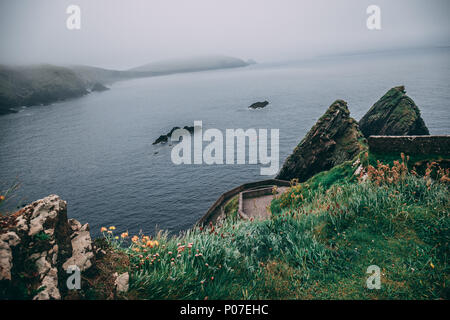 View from the iconic Dunquin harbour pier, the most westerly tip of the Dingle Peninsula in county Kerry, Ireland - Stock Photo