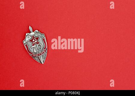 Single KGB badge commemorating 70 years anniversary. - Stock Photo