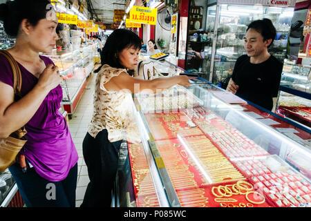 Vientiane, Laos, Southeast Asia : Laotian women shop at a jewllery store at Talat Sao Morning Market. - Stock Photo