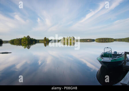 Cloud reflections. Lake Kukkia, Luopioinen, Finland. - Stock Photo