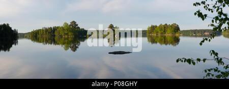 Cloud reflections panorama. Lake Kukkia, Luopioinen, Finland. - Stock Photo