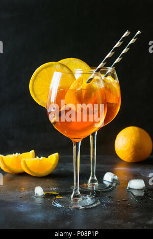 Classic italian aperol spritz cocktail on black. Close up. - Stock Photo