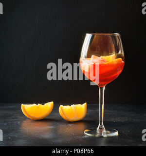 Classic italian aperol spritz cocktail on black. - Stock Photo