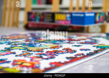 Large 1000 piece jigsaw puzzle pieces, multi colour, colourful educational family fun - Stock Photo