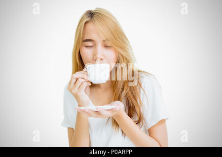 girl teen holding coffee cup to drinking coffee on white background - Stock Photo