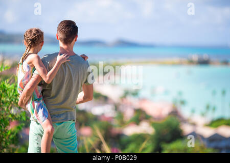 Young father and little girl enjoying beautiful views of exotic island - Stock Photo