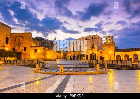 Matera, Italy, Vittorio Veneto square: Night view of the St. Domenico church and Materdomini church over the  Hypogeum ruins in the city centre - Stock Photo