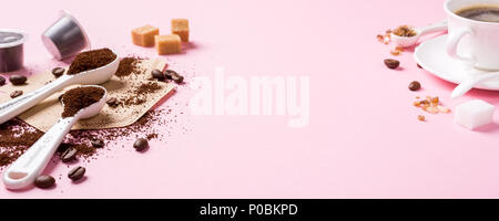 Food background with ground coffee in white spoons, coffee beans and capsules, sugar. Copy space, banner. - Stock Photo