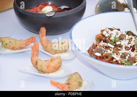 fingerfood of prawns breaded in single portions - Stock Photo