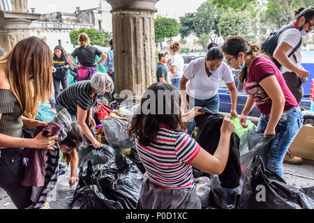 Antigua,, Guatemala -  June 5, 2018:  Volunteers load humanitarian aid supplies to take to area affected by eruption of Fuego (fire) volcano on June 3 - Stock Photo