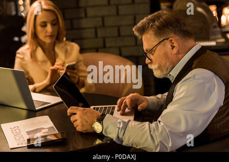 selective focus of business colleagues having meeting in cafe - Stock Photo