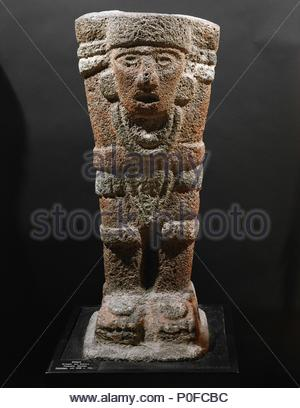 "Toltec "" atlante"", a warrior with raised arms, a triangular loin-cloth, large necklace and knee-pads. Vulcanic rock, originally red and white paint (856-1250). From Tianguismenalco, Atlixco, Puebla, Mexico. Height 29 cm. Inv. 59129. Location: Museum fuer Voelkerkunde, Vienna, Austria. - Stock Photo"