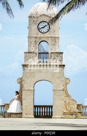 Florida Palm Beach Atlantic Ocean Worth Avenue Clock Tower beach side Hispanic girl teen quinceanera gown posing for photo - Stock Photo