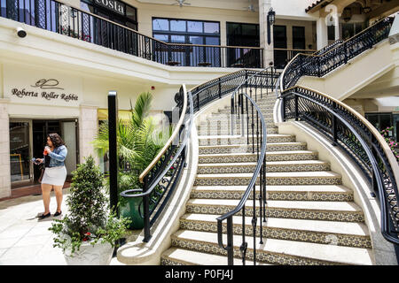 Florida Palm Beach Worth Avenue Esplanade shopping center luxury retail stores stairs woman - Stock Photo