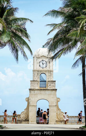 Florida, FL South, Palm Beach, Atlantic Ocean, Worth Avenue Clock Tower, beach side, sunbathers, sightseeing visitors travel traveling tour tourist to - Stock Photo