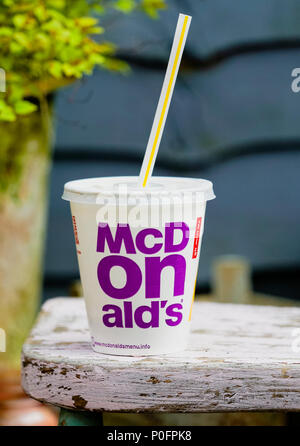 McDonald's Cola with Straw, McDonald's is the world's largest chain of hamburger fast food restaurants. - Stock Photo