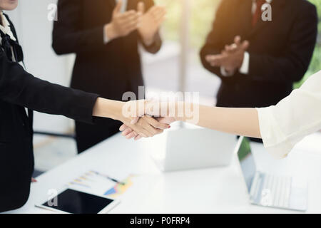 Business people shaking hands, finishing up a meeting to seal a deal with his partner business with colleague clap hands to congrats. - Stock Photo