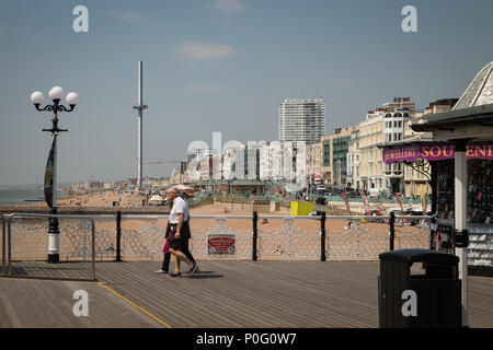 People walking along Brighton Palace Pier, Brighton, East Sussex, England, UK - Stock Photo